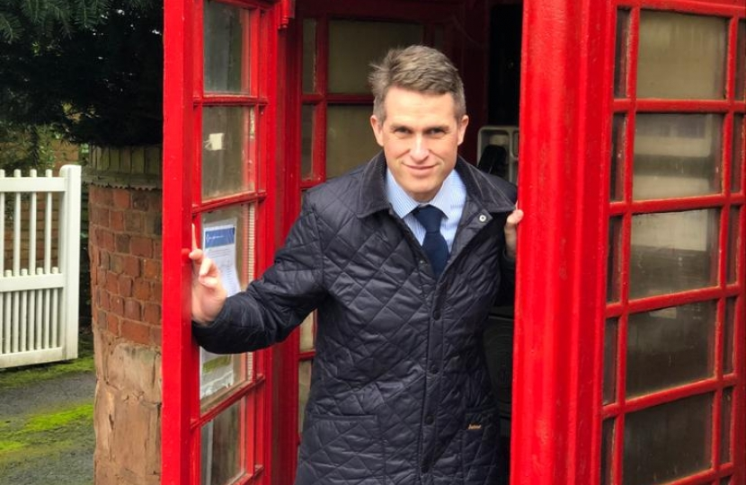 Gavin Williamson MP, standing in the historical phone box in Oaken