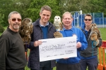 Gavin Williamson receives a cheque on behalf of the World Owl Trust